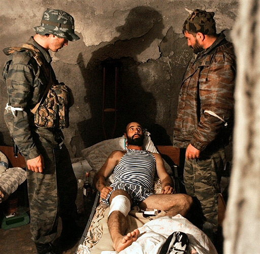 Wounded Ossetian soldier in the basement of the destroyed Zhinvali hospital