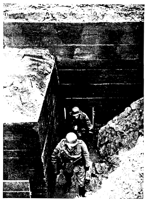 Figure 21.—Machine-gun crew leaving bunker.