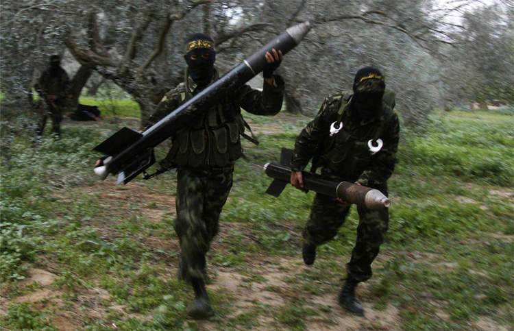 Hamas QASSAM rocketeers rushing to the launch position