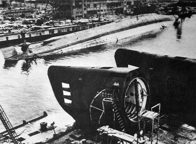 Admiral Scheer capsized in Deutschen Werke basin, in Kiel, after heavy bombing on April 9-10 1945